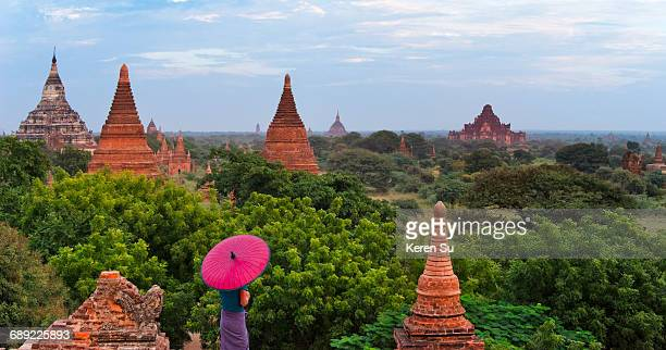 woman watching ancient temples and pagodas - myanmar stock pictures, royalty-free photos & images
