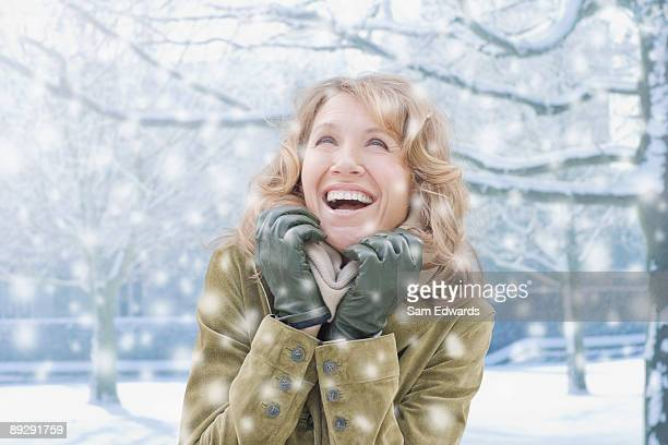 Woman watching falling snow