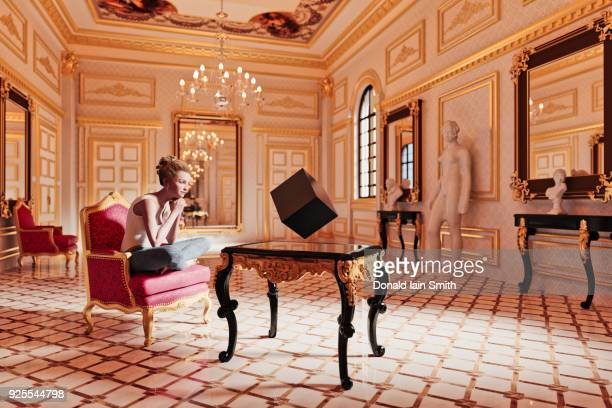Woman watching floating cube in sitting room