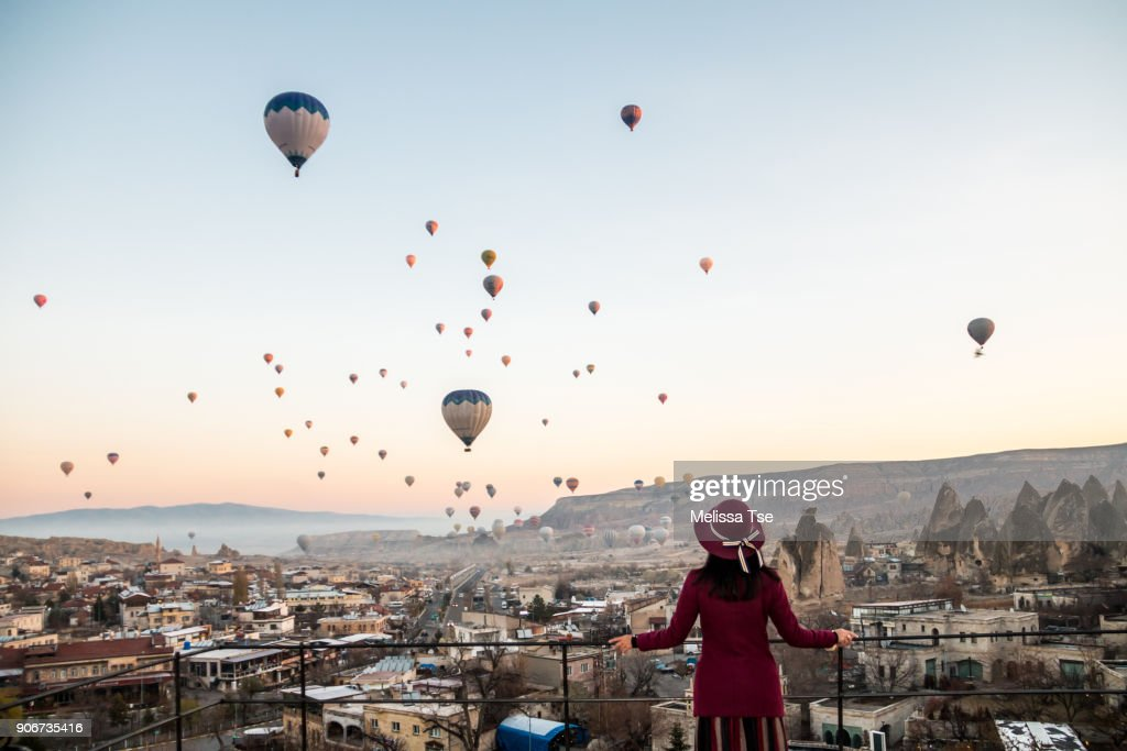 Woman Watching Hot Air Balloons in Cappadocia : Stock Photo