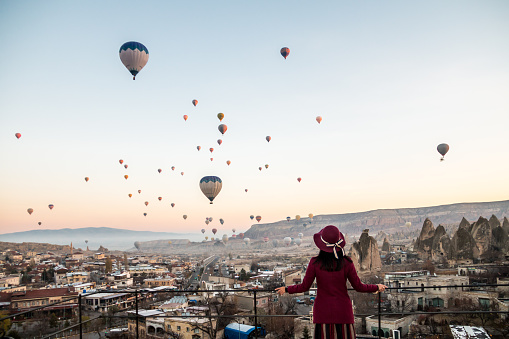Woman Watching Hot Air Balloons in Cappadocia - gettyimageskorea