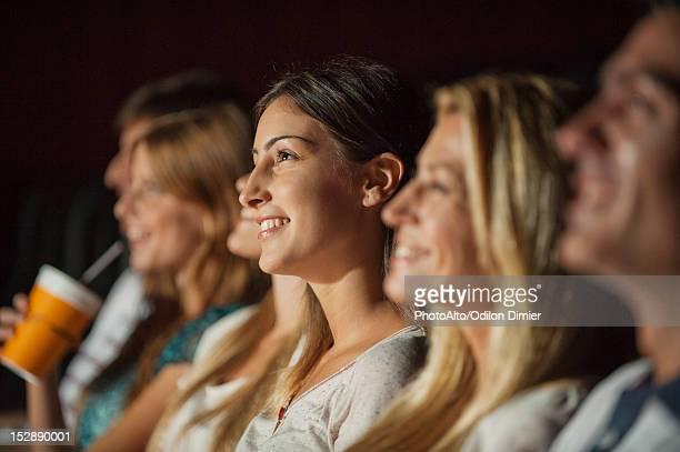 woman watching movie in theater - publikum stock-fotos und bilder