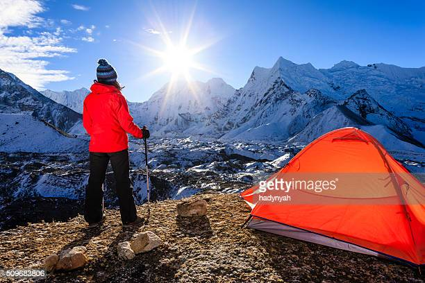 Woman watching sunrise in Himalayas, Mount Everest National Park