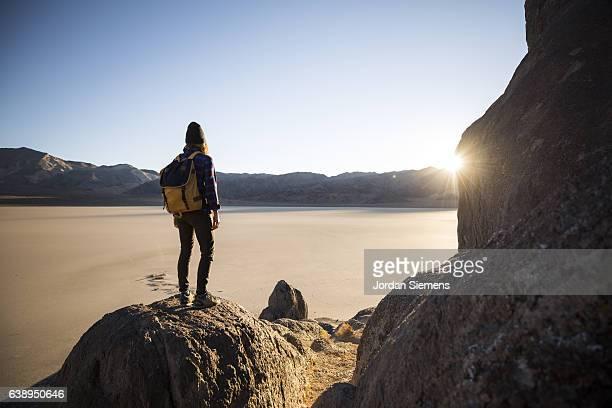 A woman watching sunrise on a hike