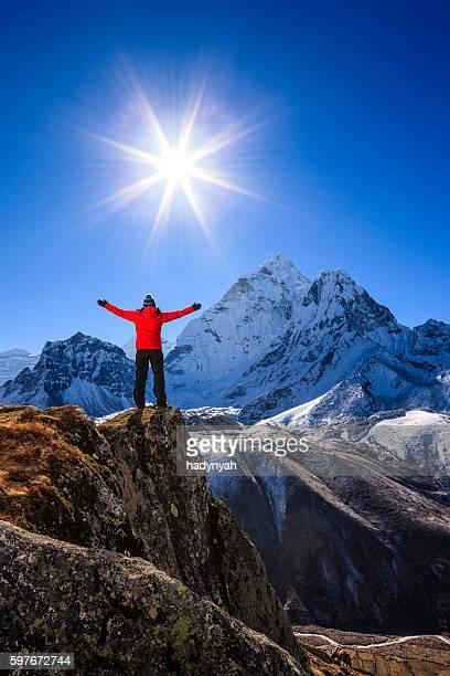 Woman watching sunrise over Himalayas, Mount Everest National Park