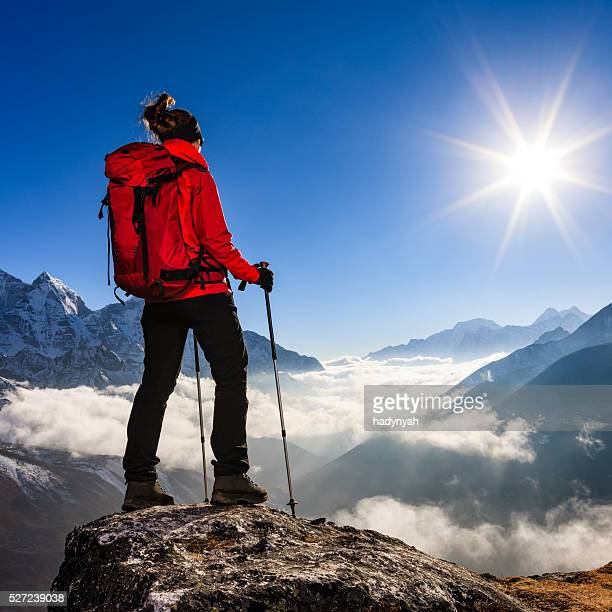 Woman watching sunset over Himalayas, Mount Everest National Park