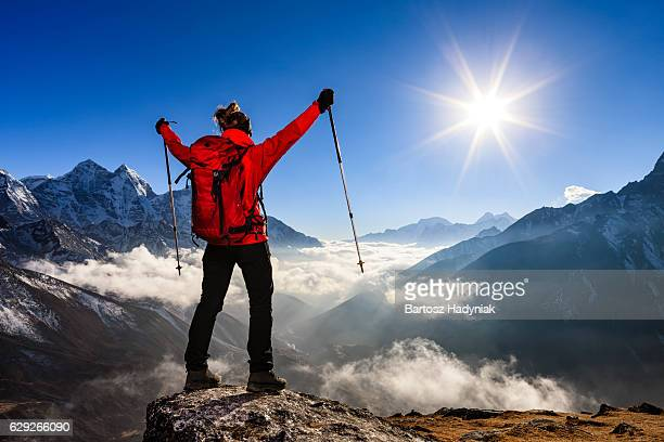 woman watching sunset over himalayas, mount everest national park - high section stock pictures, royalty-free photos & images