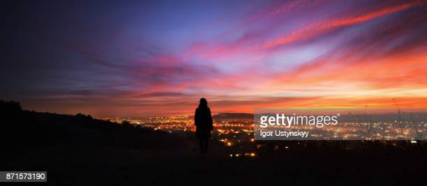 Woman watching sunset