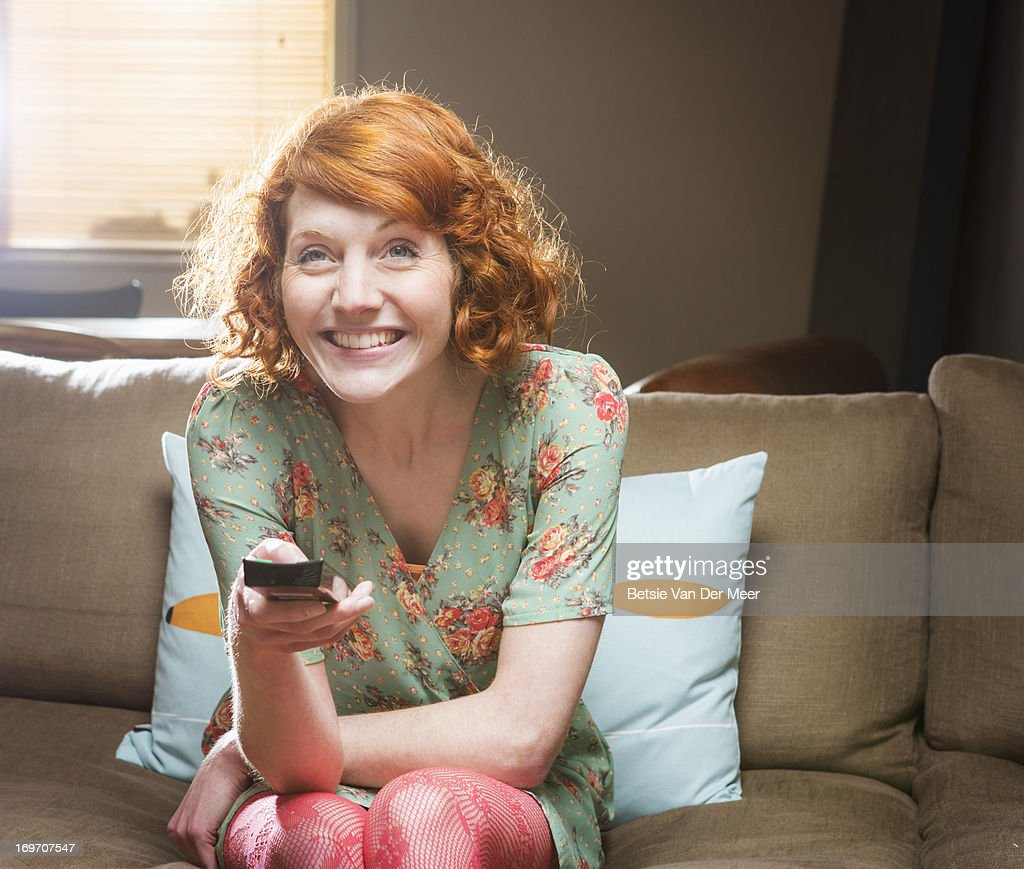 Woman watching television. : Stock Photo