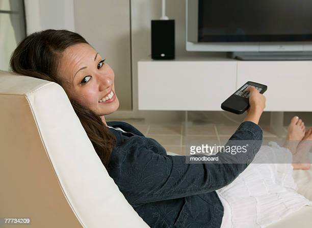 woman watching television - reclining chair stock photos and pictures