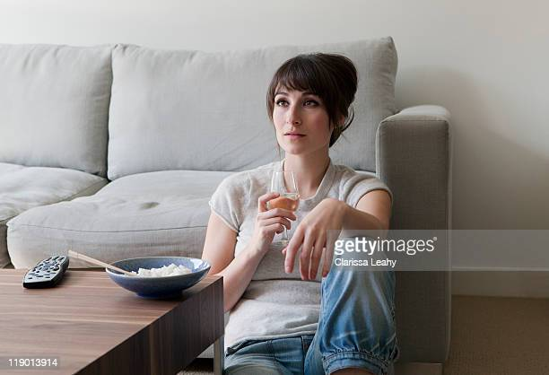 Woman watching television with dinner