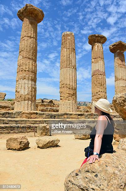 Woman watching the ancient greek temples