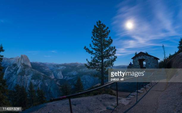 woman watching the full moon at yosemite glacier point - national landmark stock pictures, royalty-free photos & images