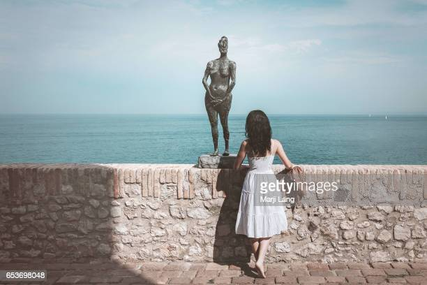 Woman watching the Mediterranean sea from the Picasso museum terrace in Antibes southern France