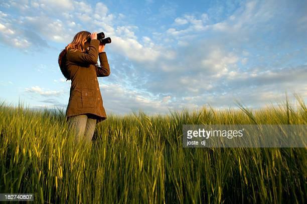 Woman watching thru binoculars