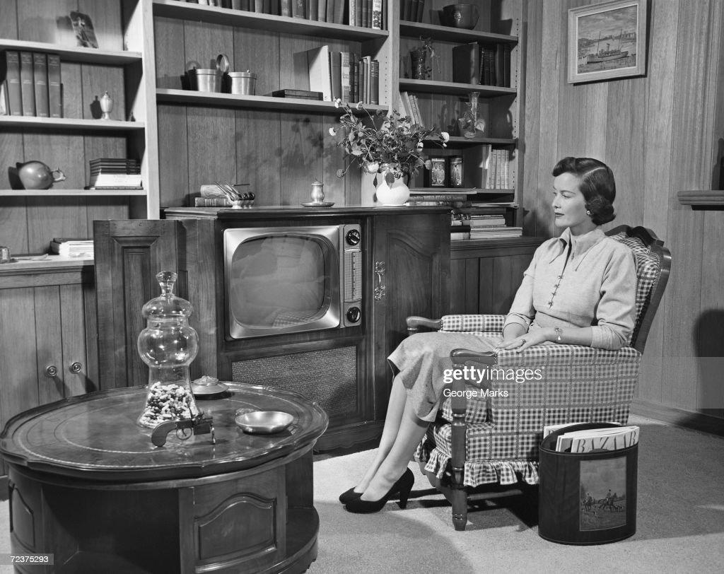 Woman watching TV (vintage) : News Photo