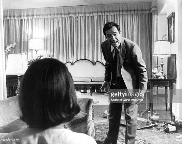 Woman watching Ugo Tognazzi talk in a scene from the film 'The Magnificent Cuckold' 1964
