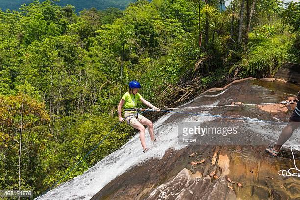 Woman waterfall abseiling