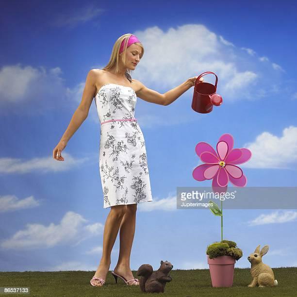 Woman watering flower