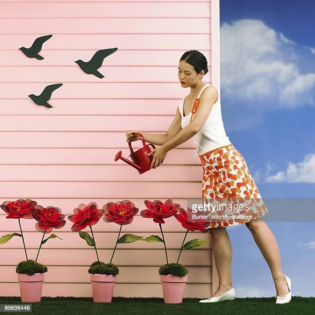 Woman watering flowers