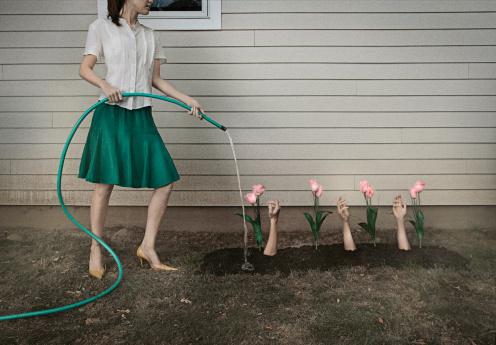 Woman Watering Garden of Arms - gettyimageskorea