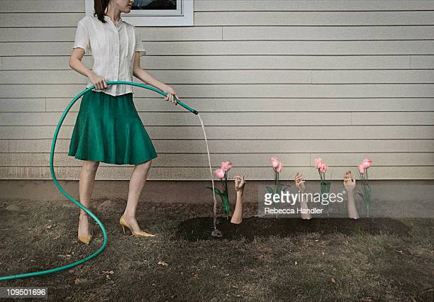 Woman Watering Garden of Arms