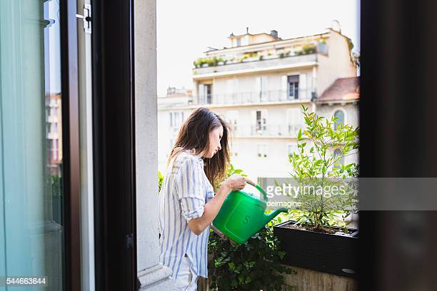 Woman watering your plants