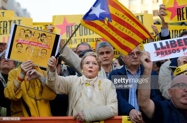 A woman waves a Catalan proindependence 'estelada' flag during a demonstration with the lemma 'Republic is freedom' in favour of the Catalan republic...