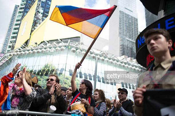 A woman waves a flag during a rally to commemorate the 1915 Turkish massacre of Armenians in Times Square April 26 2015 in New York City The rally...