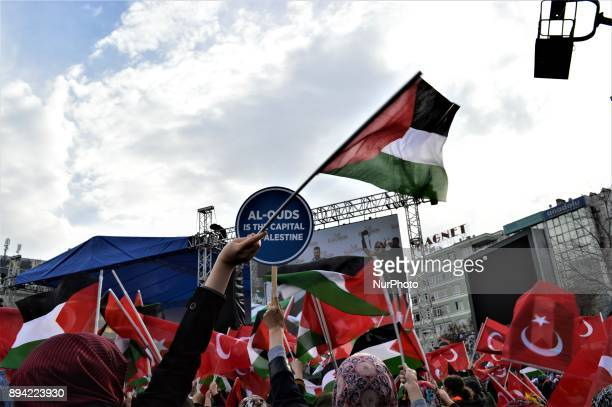 A woman waves a Palestinian flag as proPalestinian protesters take part in a rally against US President Donald Trump's recognition the city of...