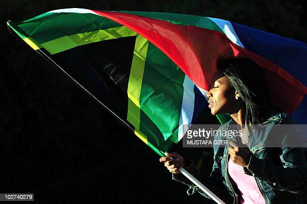 A woman waves a South African flag in front Wanderes Stadium in Johannesburg on June 8 2010 before a friendly match between Portugal and Mozambique...