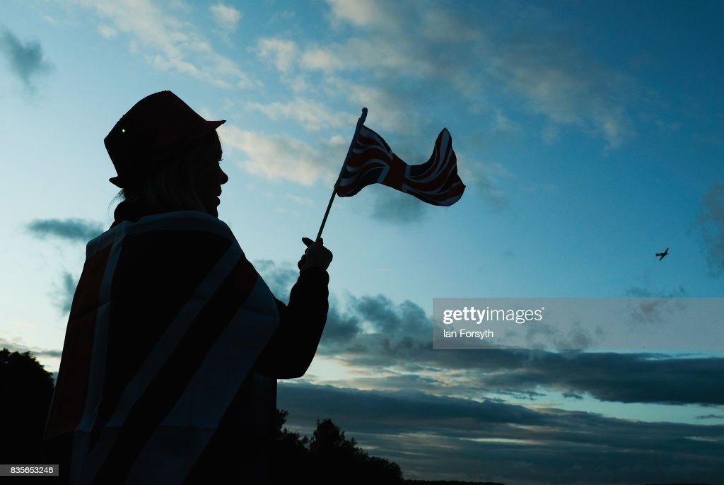 A woman waves a Union Flag as an RAF Hurricane from the Battle of Britain Memorial Flight performs a fly past during the annual Castle Howard Proms Spectacular concert held on the grounds of the Castle Howard estate on August 19, 2017 in York, England. The outdoor picnic concert celebrated the best of British with a rousing medley of traditional orchestral anthems from the London Gala Orchestra conducted by Stephen Ellery and special guest performances from Brit award winners Blake and soprano Joanne Forest.