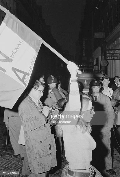 A woman waves an anticommunism flag during civil unrest in Paris France 30th May 1968