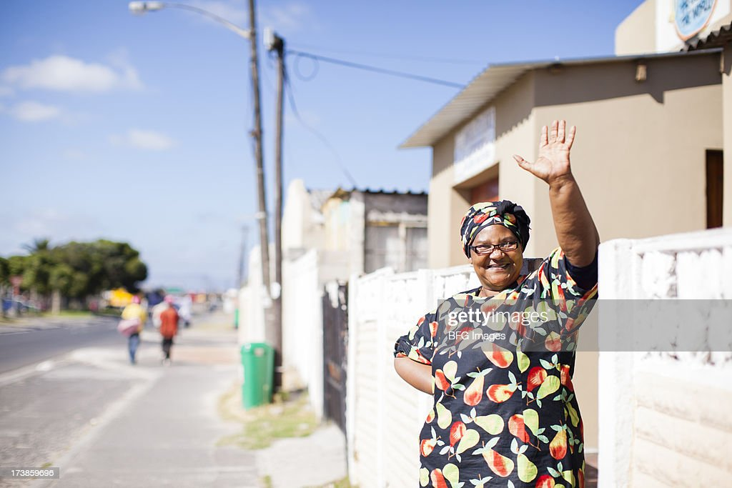 Woman waving and smiling, Cape Town, South Africa : Stock Photo