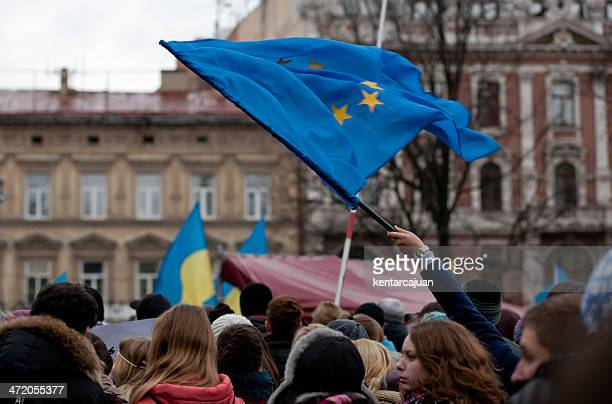 Woman waving EU flag in western Ukraine