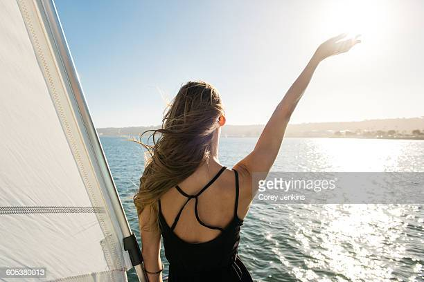 Woman waving on sailboat, San Diego Bay, California, USA