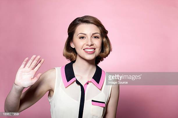 woman waving - waving gesture stock photos and pictures