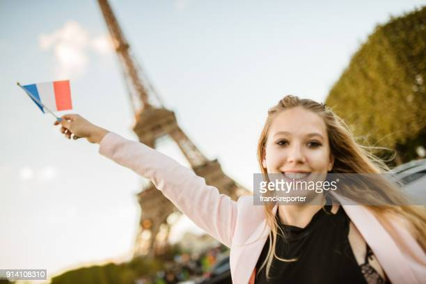 woman waving the flag in paris