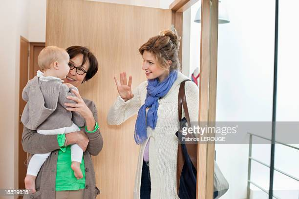 woman waving to her daughter - nanny stock pictures, royalty-free photos & images