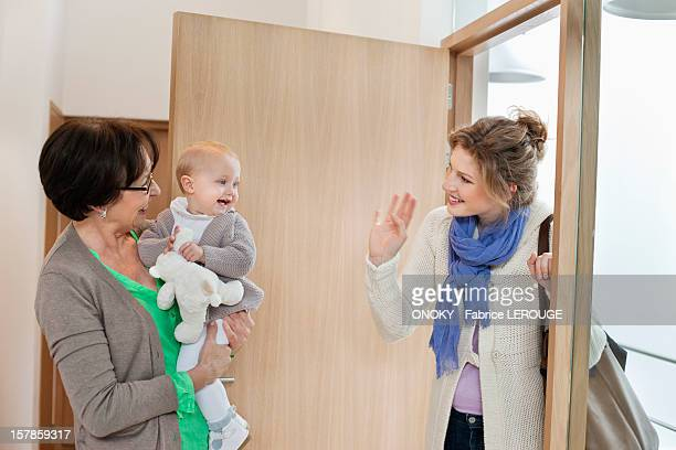 woman waving to her daughter - nanny stock photos and pictures
