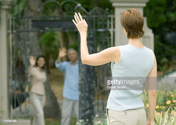 Woman waving to neighbors