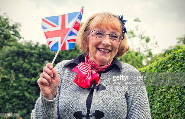 Woman waving union jack flag
