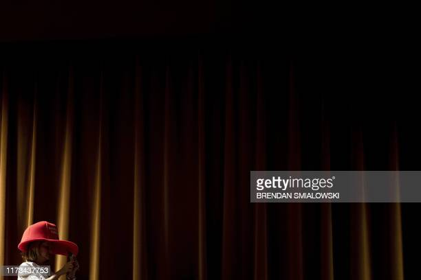 TOPSHOT A woman wear a Make America Great hat as US President Donald Trump speaks before signing an executive order regarding Medicare at Sharon L...