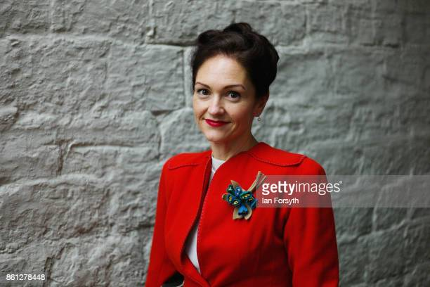 A woman wearing 1940's period clothing poses for a picture during the North Yorkshire Moors Railway 1940's Wartime Weekend event on October 14 2017...