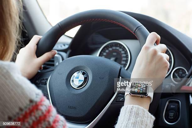 Woman wearing 38mm stainless steel Apple Watch