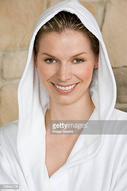 woman wearing a bathrobe - mid adult women photos stock pictures, royalty-free photos & images