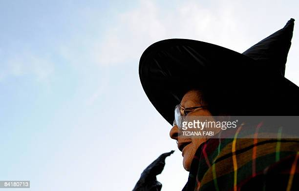 A woman wearing a Befana outfit takes part in the annual Befana parade in Viterbo on January 5 the day before Epiphany A 52 meter long stocking is...