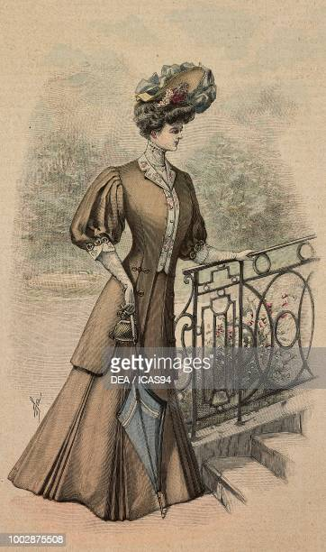 Woman wearing a beige Drap dress long jacket with puffed sleeves and a hat with ribbons creation by Amy Linker colored engraving from La Mode...