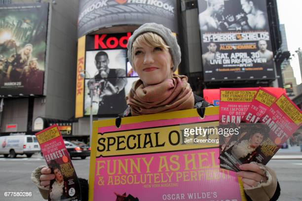 A woman wearing a billboard offering ticket discounts in the Theatre District Times Square