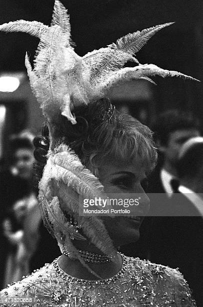 A woman wearing a bizarre hat at the Grand Bal Par¸ evening held for the reopening of the Salon de l'Europe at Monte Carlo Casino Monte Carlo 13th...